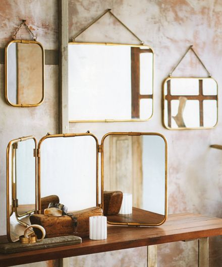 The sinuous curves of these burnished brass mirrors from Roost are a nod to the Art Deco era. The hanging style come in three different sizes, affixed with brass chains and the triple panel mirror can either hang or stand.