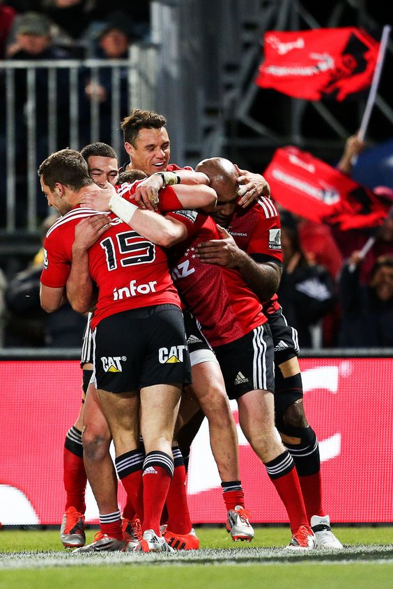 Crusaders players celebrate Mitchell Drumond's try