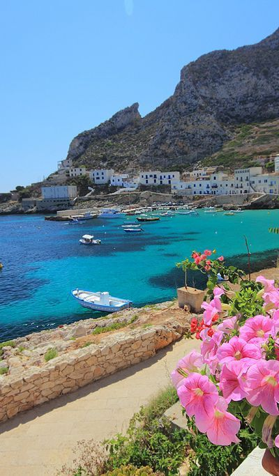 Sicily, Italy. My great-grandparents came   to the US from Sicily. I didn't get a chance to visit last time I was in Italy   and would love to visit there.