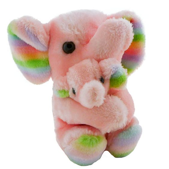 """Like New pink mama elephant holds her baby snugly with velcro. Mama and baby have striped inner ears, mama also has striped feet. Mama sits about 7"""" and baby is about 4.5""""They were made in Korea sometime in the late 80's The back of the tush tag is printed in French. Imported by Cobra/$8.95"""