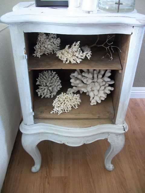 Use little blue cabinet to display coral pieces.