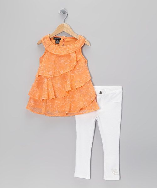 Boasting a delicately textured print and tiers of bold ruffles, this gem of a dress is ready to wow on the playground and beyond. The included leggings add some cozy fun with their elastic waistband and snug fit.Includes dress and leggingsDress: 100% polyesterLeggings: 54% cotton / 42% polyester / 4% spandex