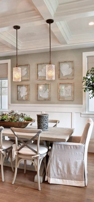 I love the wall color, white chair rail, worn looking woods and linen fabric: