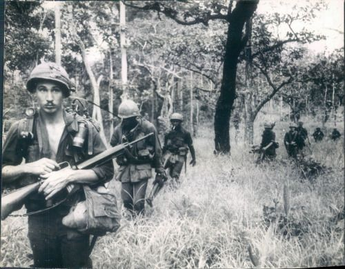 The unseen enemy A 12-man American infantry squad walks softly trough the jungle in South Viet Nam half a mile from the Cambodian border. In fifteen minutes, five of these men will be wounded, two of them nearly dead. UPI PHOTO 8-6-66