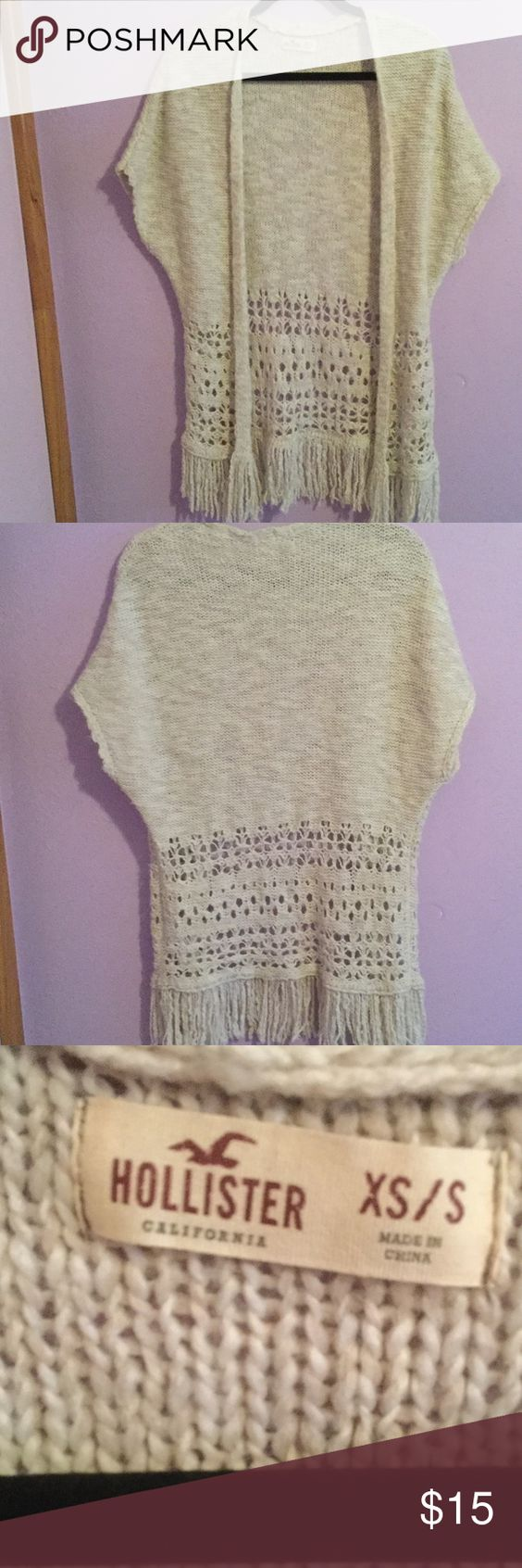 Hollister sweater Cute tan sweater with holes at the bottom. In great condition!! Worn only a couple times Hollister Sweaters Cardigans