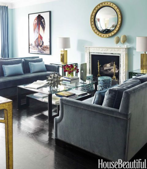 """A good coffee table is your money shot,"" Lincoln says. The two-tiered blackened steel-and-glass design by John Boone echoes the form of the Billy Baldwin side tables and the arms of George V sofas covered in Big Dreams Velvet in Malibu, both from Holly Hunt. Ceramic garden stools from Inner Gardens offer extra seating in front of the fire."