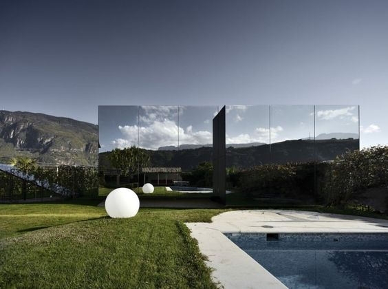 Mirror Houses / Peter Pichler Architecture - The Mirror Houses are a pair of holiday homes, set in the marvellous surroundings of the South Tyrolean Dolomites, amidst a beautiful scenery of appletrees, just outside the city of Bolzano. They were designed by architect Peter Pichler. After 30 years in their farmhouse outside Bolzano, in northern Italy, and with their children grown up, Josef Ebner and Angela Sabine Staffler found themselves with surplus space...