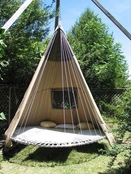 Re-purposed trampoline becomes a hanging teepee bed. #camping #outdoors