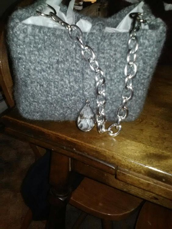 """I put a silver buckle strap on this gray bag and used an I-cord flap knitted to a silver trimmed crystal bobble for the flap. Finished size:  9"""" wide, 7"""" tall, and 6"""" wide on sides."""
