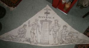 19th century triangular bandage cloth. Gives instructions on how to tie the bandage on various wounds. Printed onto cotton. Registered SANOID, C,G,C Bandage, 12576. (sallie_ead/Lucia's Wardrobe, eBay)