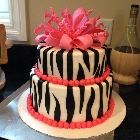 Pink zebra birthday cake for a one year old birthday party.