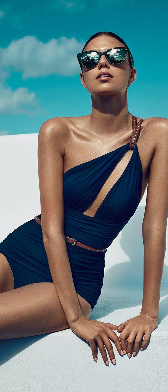 Tan in style with #MichaelKors swimwear.