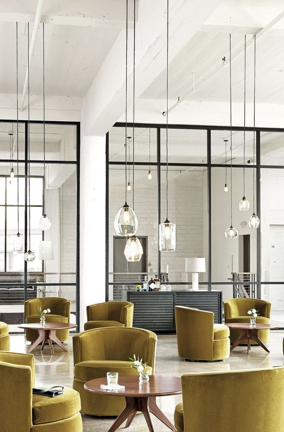 Sky Pendants. A beautiful room with statement mustard armchairs. #hospitalityfurniture #hospitalityprojects #luxuryrealestate See more: http://www.brabbu.com/en/inspiration-and-ideas/category/world-travel/restaurant-bar