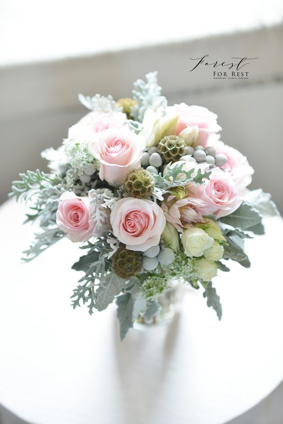 Rose, scabiosa pod, dusty miller bouquet  pink and silvery green  Facebook: Forest for Rest