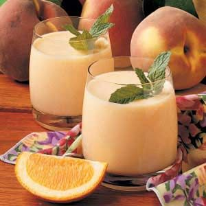 Peach Smoothies-•2 cups milk  •2 cups frozen unsweetened sliced peaches  •1/4 cup orange juice concentrate  •2 tablespoons sugar  •5 ice cubes  Directions  •In a blender, combine all ingredients; cover and process until smooth. Pour into chilled glasses; serve immediately. Yield: 4 servings