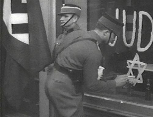 German stormtroopers painting anti jewish graffiti on a for Window in german