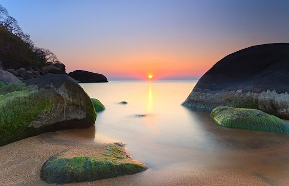 Glimmer - My first african sunrise, taken in Lake Malawi, the 3rd largest in africa and 8th in the world. A lake so big it borders 3 countries.
