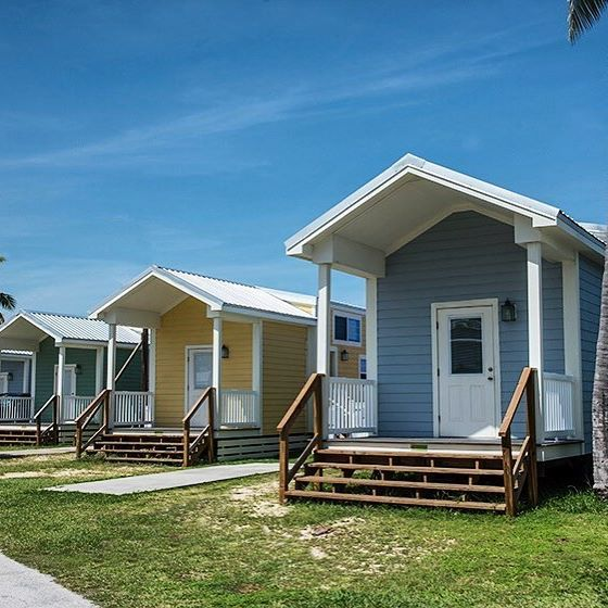 These Charming Colorful Cottages Come With Oceanfront Views Reserve This Petite Retreat At Fiesta Key Rv Resort I Colorful Cottage Retreats Tiny House Village