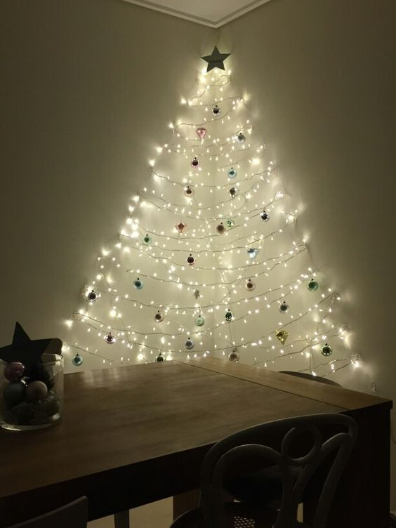 A Wall Mounted Christmas Tree Of Lights And Ornaments Created Between Two Walls To Mak Wall Christmas Tree Creative Christmas Trees Wall Mounted Christmas Tree