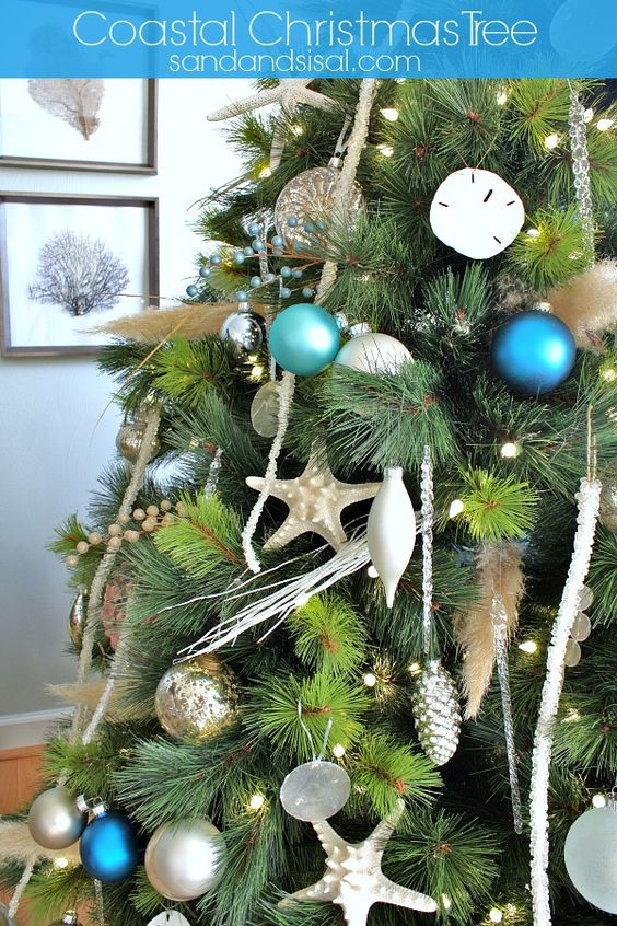 Unique seaside accents adorn @Sand and Sisal's Coastal Christmas Tree #ChristmasInJuly