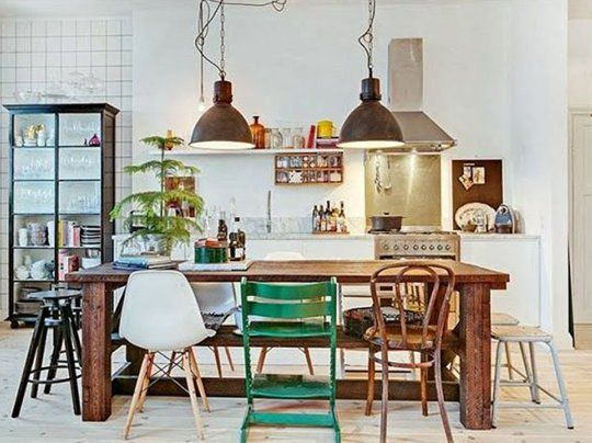 I like the idea of having a big table do double-duty as an island in a kitchen/dining area. From Apt. Therapy.