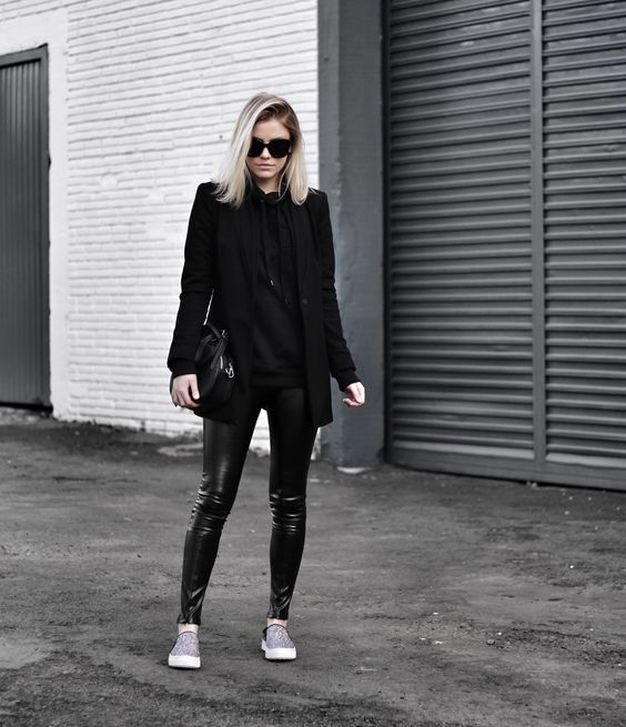 all black: sweatshirt, blazer and fake leather pants.