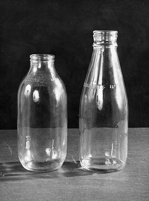 Milk bottles (1973) we used to have a metal box on the steps outside so the milkman could put the bottles inside and take his payments... The boxes were not refrigerated!