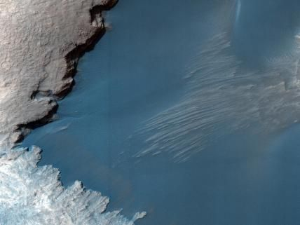 Blue on Mars This image shows part of the floor of Rabe Crater, a large impact crater in Mars' southern highlands.