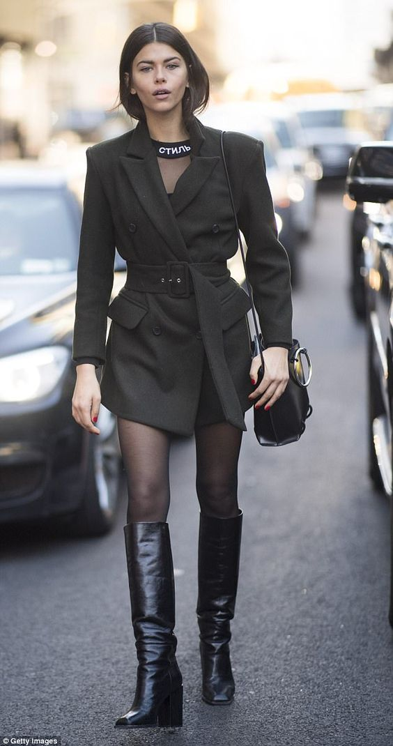 Those boots were made for walking! Model Georgia Fowler makes an entrance at NYFW in barel...