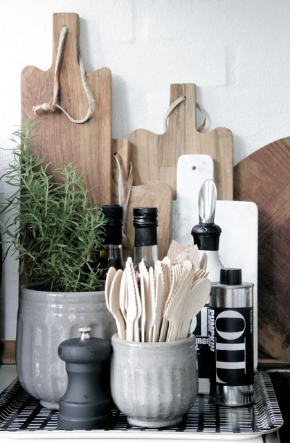fresh kitchen styling vignette of cutting boards and containers