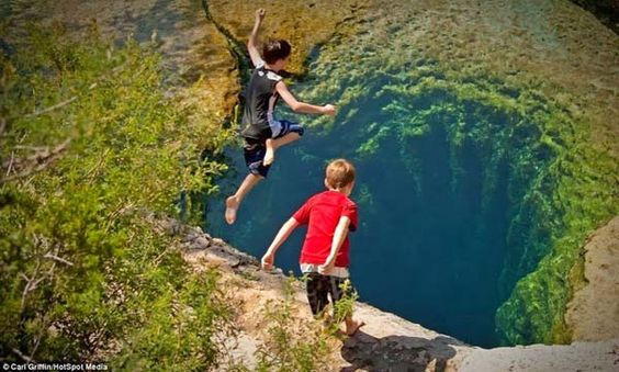 "Jacob's Well is a natural ""karstic spring"" in the Texas Hill Country. It's located northwest of Wimberley, Texas,:"