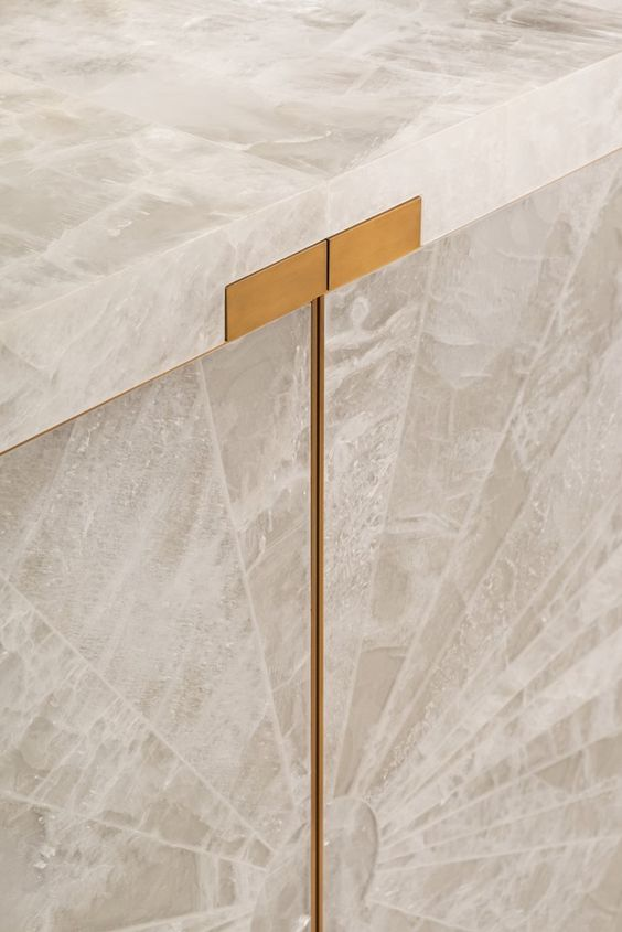 The newest addition to our collection of Gypsum bespoke furniture, designed by Jean-Paul Viollet. This stunning sideboard is entirely covered in gypsum embellished with gold patinated bronze accents. A sunburst pattern radiates across the front emphasizing the natural luminosity of the material.