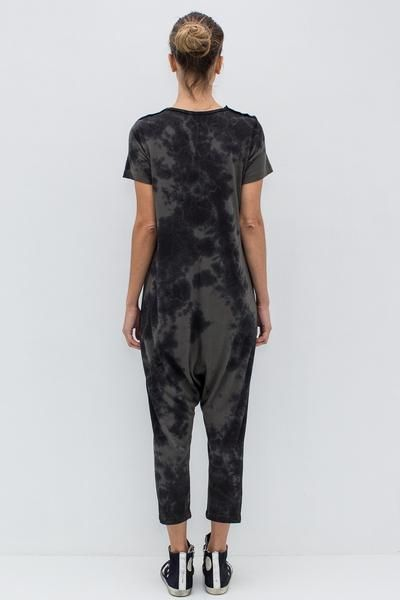 """50% Cotton, 50% Polyester Drop-crotch silhouette Scoop neckline Short sleeves with button detail Slips on Color: Army Tie Dye Model is 5'9"""" and wears a size T0."""
