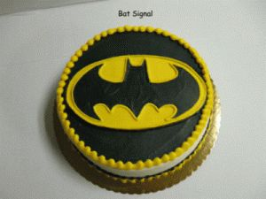 Batman Cake - Yellow icing, make 2 stencils, fill in with black/gray sprinkles, decorate outside perimeter and base with reeses? Double layer or quadruple layer depending on if we have a party or not this year.