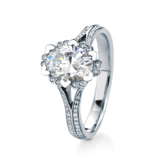 IRIS/OVAL/PAVE by MaeVona: Beautiful floral solitaire named after the Scottish Wildflower Iris. Heart-shaped prongs frame the center stone, accentuated with delicate diamond accents between the prongs and on the split shank.