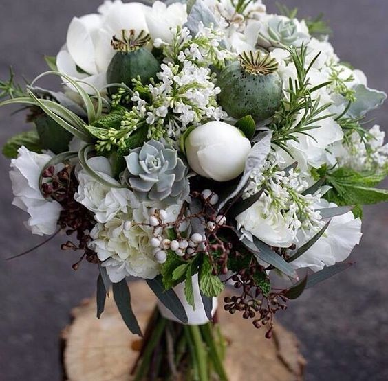 Gorgeous Hand Tied Wedding Bouquet Comprised Of: White Peonies, White Ranunculus, White Lisianthus, White Lilacs, White Hydrangea, Green Airplants, Gray-Green Succulents, Green Poppy Pods, Dusty Miller, Silver Brunia, Green Seeded Eucalyptus, Fresh Rosemary