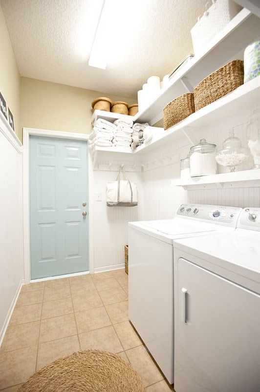 Laundry organization plenty of shelf and hanging space for Open shelving laundry room