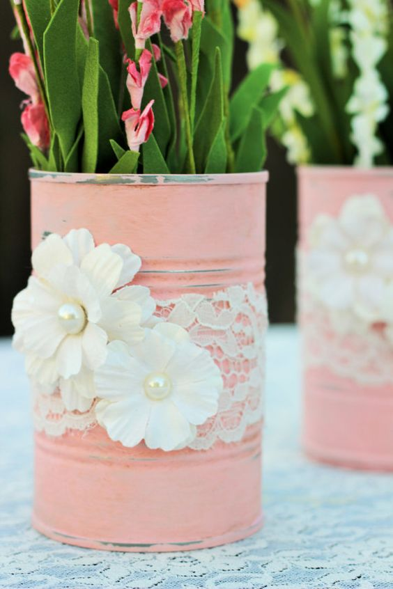 These two re-purposed tin cans are painted in a pink chalk paint and adorned with paper flowers and lace trimming. Created in a shabby chic: