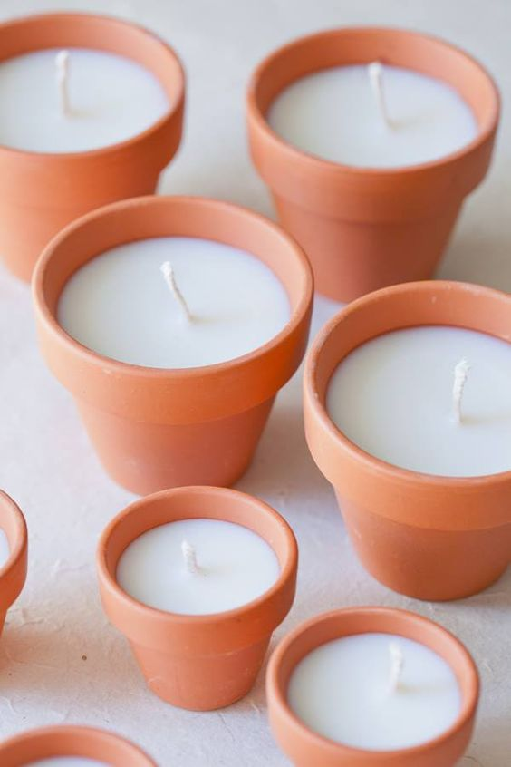 diy terracotta votive candles    Add a beautiful glow to an outdoor area with these charming DIY terracotta votives! They make beautiful gifts too! and you can decorate the pot to personalize the gift  Tip from Daw I add 1 or 2 drops of essential oil of your choice to scent the wax or you can buy the scented wax from craft stores