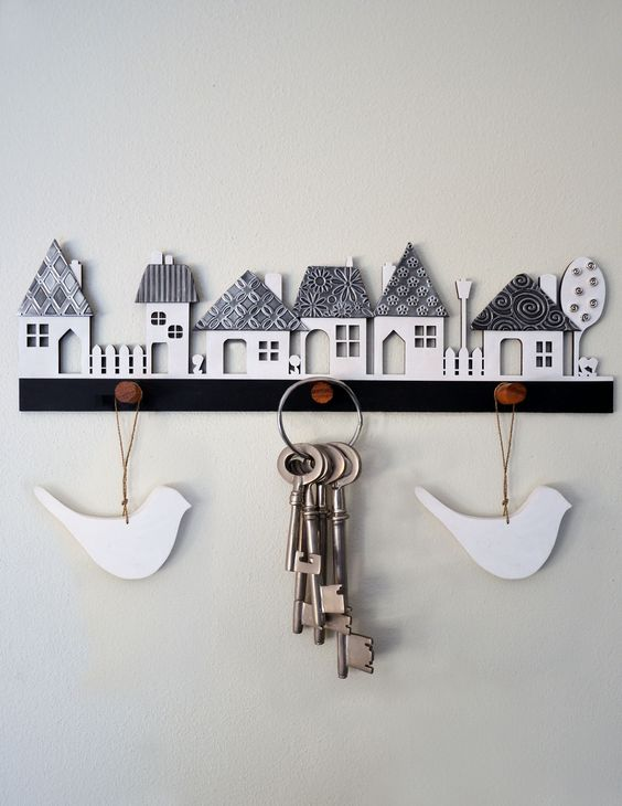 Village wooden cutout with pewter textured roofs, kit form from Mimmic Gallery and Studio