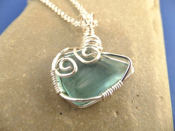 N15 Aqua wire wrapped pendant on silver plate chain