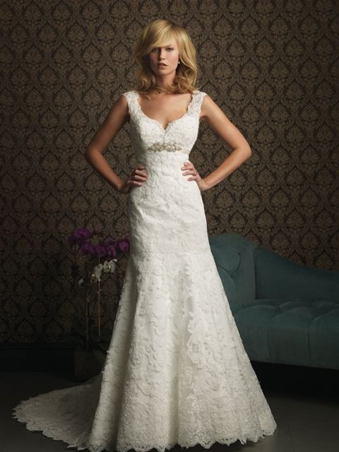 Allure 8770: This gorgeous style is created from a rich lace appliqué on soft net. The sculpted neckline features scalloped straps and a v-shaped back. The empire waist is accented with a Swarovski crystal brooch.