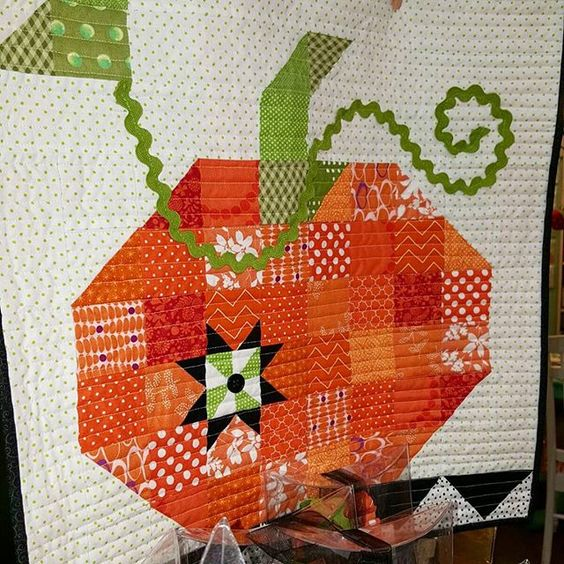 Not a fan of the pumpkin carving mess? Then maybe this cute mini pumpkin quilt is more your style?
