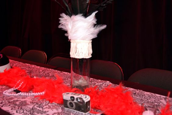 Boas, Pearls, Gansta Hats and Disposable cameras lined the tables