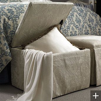 at the foot of the bed... practical and pretty