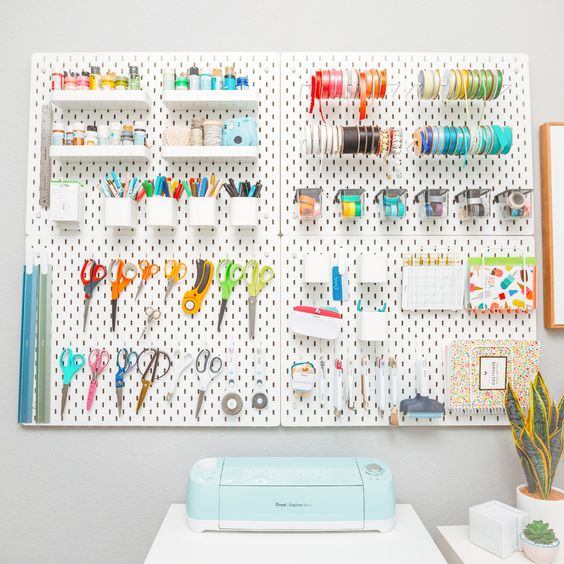 IKEA SKADIS pegboard holding craft supplies