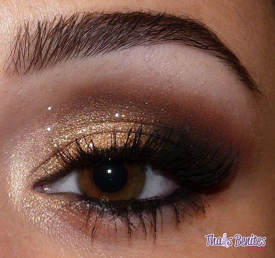 Smokey eye with gold eyeshadow.