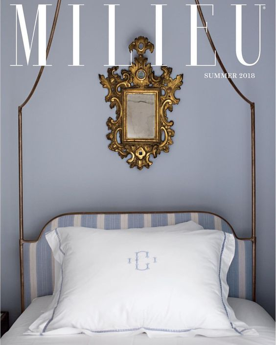 Milieu magazine cover with periwinkle blue wall in a classically designed bedroom. #milieu #bedroom