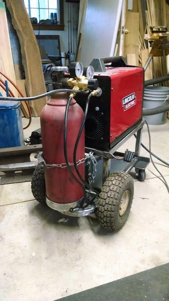 Scrap metal welding cart made to store under my workbench.