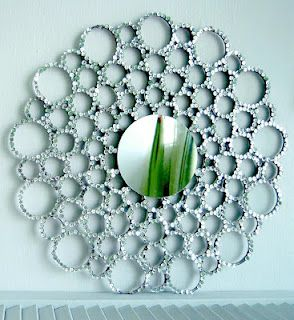 Stunning DIY mirror using an old lid, sequins, and toilet paper rolls. Lovely.